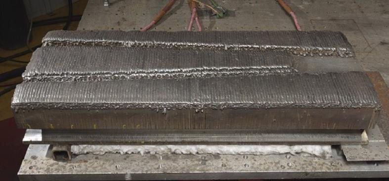 Close-up of the test block with weld layers applied
