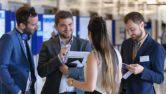 Dimitrios Fakis (centre left) speaking to other students at the NSIRC 2019 Annual Conference. Photograph: TWI Ltd / NSIRC