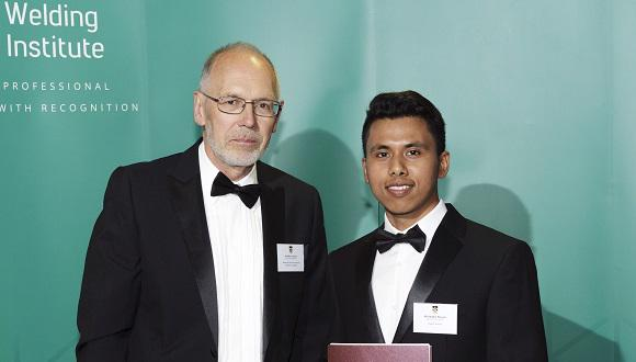 Dibakor Boruah receives his Armourers and Brasiers Best PhD Award from Mike Goulette
