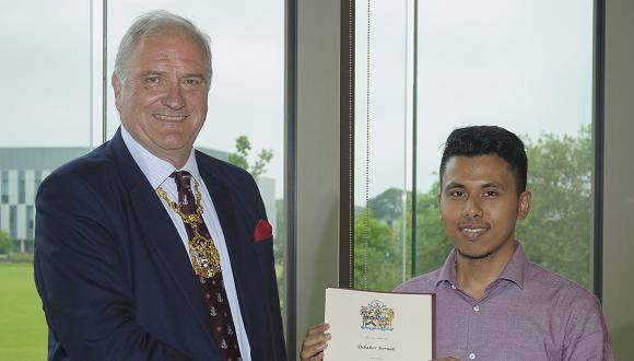 Dibakor Boruah presented with his Armourers and Brasiers Travel Award by Christopher Weston-Simons