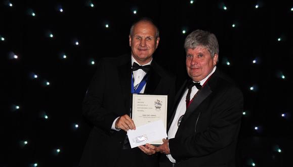 Ian Cooper (left) receives his award