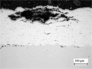 Fig. 12. Cross section through coating after exposure to test solution for 20 hours to illustrate corrosion along inter-particle boundaries