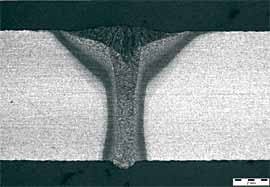 Fig. 1. Cross-section through a hybrid weld made over a flush, close fitting V butt joint. 2mm scale bar