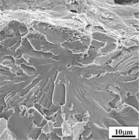 Fig.17a) Scanning electron micrograph of the cleavage initiation area in front of the fatigue crack-tip of specimen no. 9, representative of the toughest CTOD specimens (Group 2), characterised by large local plastic strain and microductility