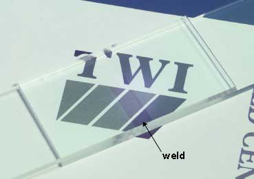 Fig. 2. Transmission laser overlap weld in clear PMMA made with an infrared absorbing medium impregnated film at the interface
