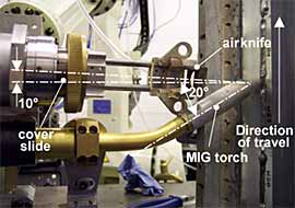 Fig.1. The process set-up used for the welding trials in the vertical-up (PF) welding position