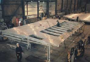 Fig.6. FSW catamaran side-wall with cut-out sections for windows at Marine Aluminum in Haugesund, Norway [14]