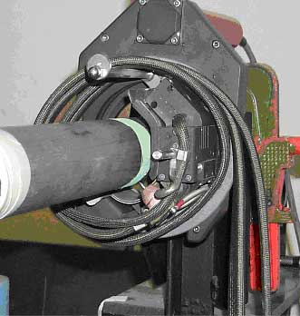 Fig.3. MESSER Polysoude welding equipment used for the orbital welding of tube. Note the flux coating on the tube prior to welding