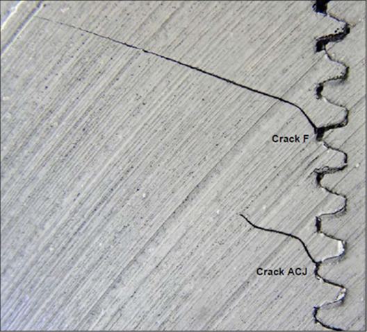 Figure 14 - Two fatigue cracks from different threads