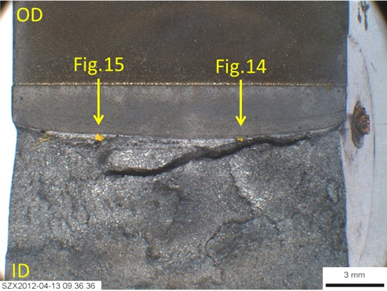 Figure 9. Fracture surface of sample W01-50, showing two yellow dots (indicated by arrows), for the potential pop-in initiation sites. Arrows also give the planes of sectioning. Note the split beneath the test fracture