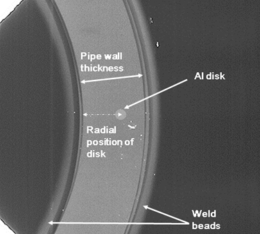 Fig.6 Radiograph showing final position of aluminum disc after welding