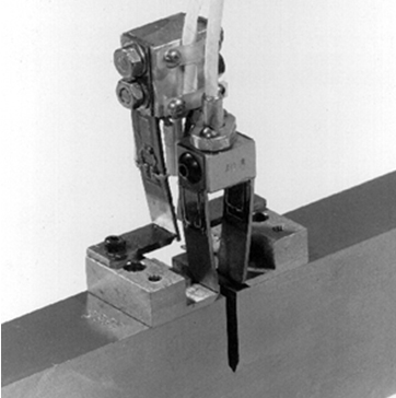 Fig 4. An example of a double clip gauge arrangement at the crack mouth of a fracture toughness test specimen
