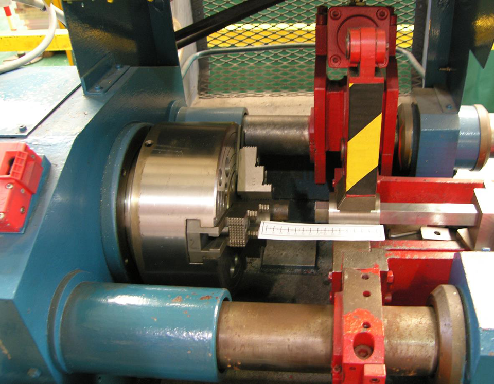 Figure 14 Set-up for friction welding round bar onto the end of square section SENT blanks, which were held in a custom-made holder for the specimen dimensions.