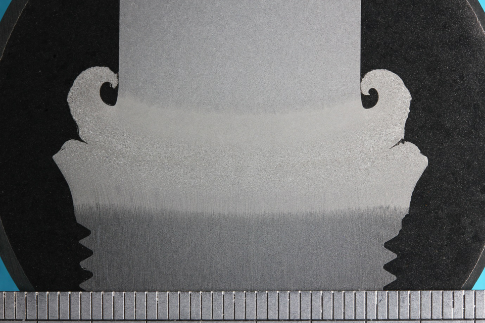 Figure 17 Macro section through a friction weld used to attach threaded ends to some of the SENT specimens.