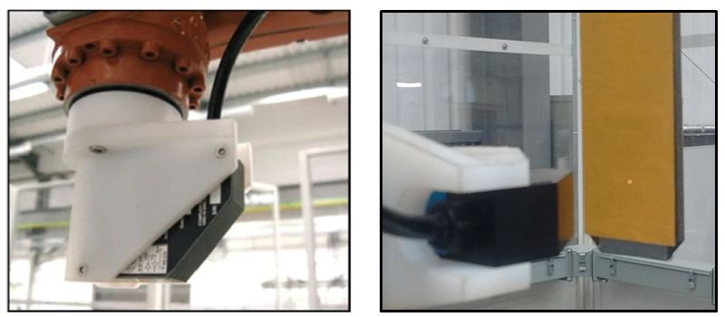 Figure 3 - Acuity AR200-100 sensor attached to robot (left). Laser dot reflected off tool on second robot (right)