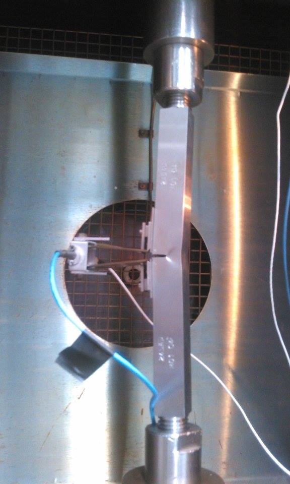 Fig. 3 Machined threaded-end SENT specimen gripped inside a thermal chamber