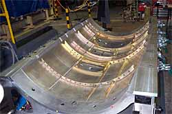 Skin, stringers and frames have been joined via friction stir welding to complete the cabin right-hand panel assembly. ( Photograph courtesy of Eclipse Aviation Corporation)