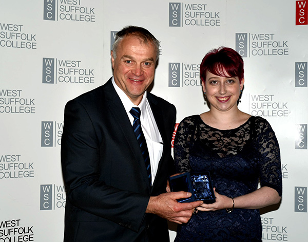 Rebecca Duffy with the Advanced Engineering Apprentice of the Year Award, presented by TWI's Edward Watts