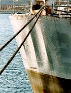 Dishing of the steel plate between longitudinal stiffeners can be seen clearly on the bow of this ship (Courtesy MOD)
