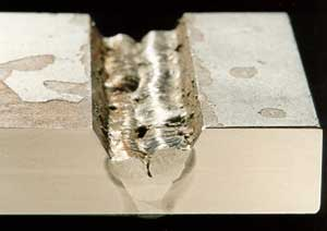 Fig. 2. The influence of welder technique on the risk of slag inclusions when welding with a basic MMA (E7018) electrode a) Poor (convex) weld bead profile resulted in pockets of slag being trapped between the weld runs