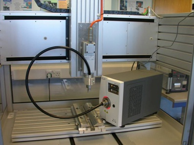 Figure 5: Large bed µFSW machine at TWI with supplementary radiant heating delivered by fibre to the µFSW head