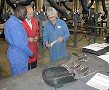 Colin Eileens (far right) outlines the requirements and welding standards to course tutor Garry Rodmell (centre) and learner Kouadio Assua (left)