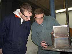 Kevin and Stuart reviewing plate assembly