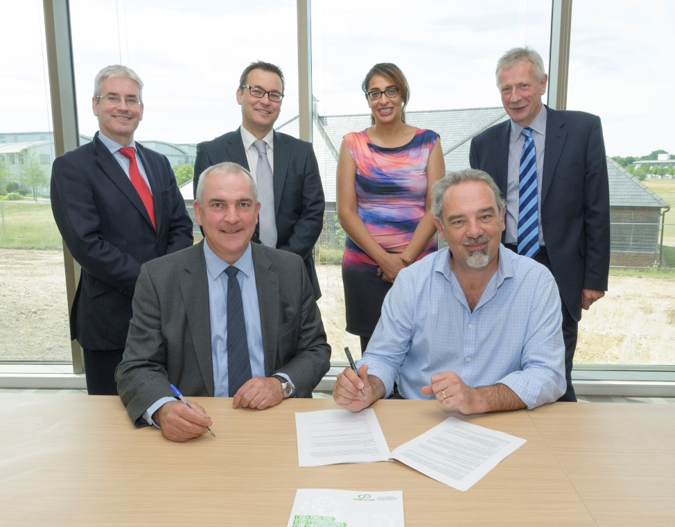 Mark Reeve, Chair of GCGP LEP completes the signing for the refurbishment of the Robert Jenkin's Laboratory with TWI's Christoph Wiesner