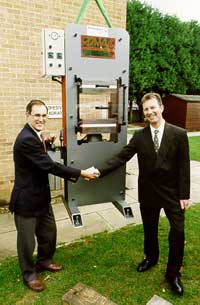 Paul Burling (right) takes delivery of the press from Brian Croft of Rotherwood Machinery Ltd