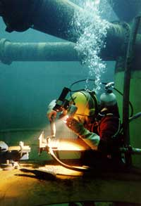 Underwater flux cored welding taking place in the diving tank at TWI North