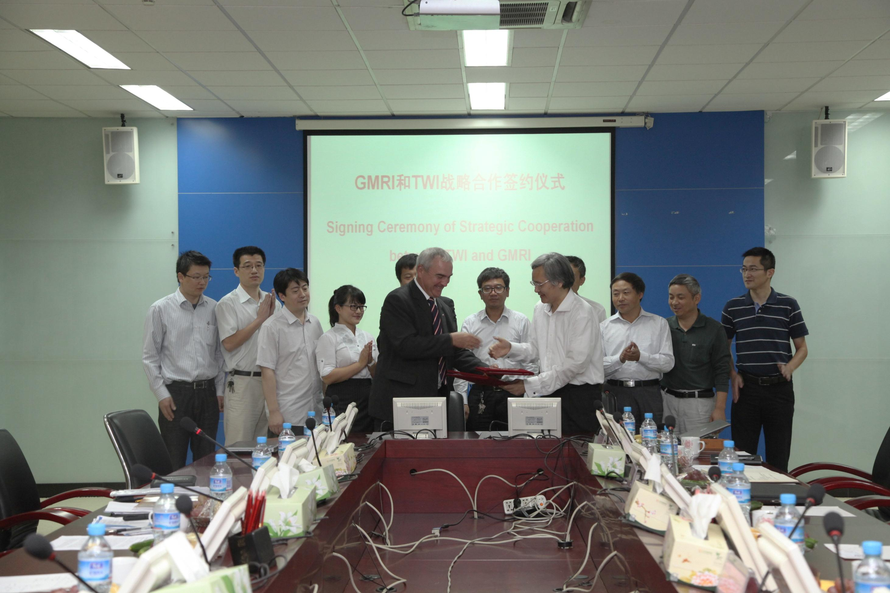 TWI CEO Dr Christoph Wiesner signs the contract with Prof Xuedong Chen (President of GMRI) at GMRI in October, 2012