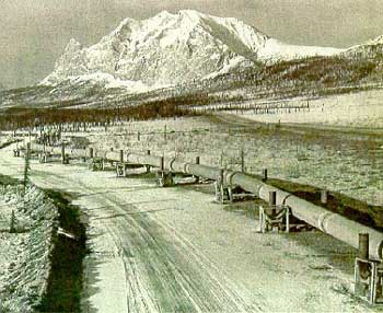 The pipeline snakes south with Mount Sukakpak in the background (Courtesy British Petroleum)