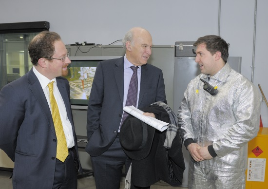 Demonstrating hand-operated laser cutting for nuclear decommissioning - TWI's Matt Spinks talks with Vince Cable and Julian Huppert.