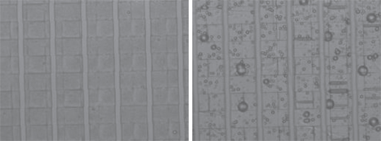 Fig. 3 SEM images showing 495PMMA A8 resist after EB exposure and developing. The lines exposed to the EB are 25μm wide and separated by 5 μm wide tracks. The resist has been removed along the 25μm lines. The left image exposed at 200 μC/cm2, shows n