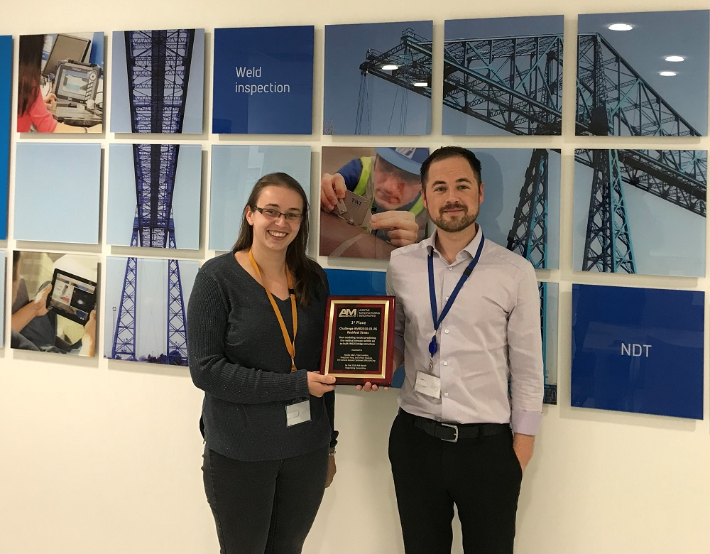 Madie Allen, National Structural Integrity Research Centre (NSIRC) student at Brunel University London and Tyler London, Team Manager, Numerical Modelling and Optimisation, TWI Ltd, with the team's AM-Bench Challenge award.